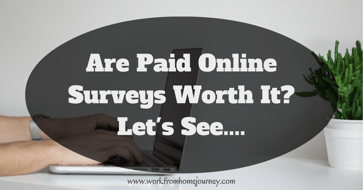 Are paid online surveys worth it? Man working at laptop computer