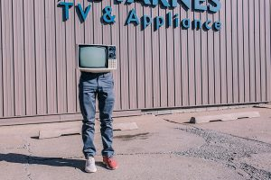 Gratisography Photo - TV on human legs