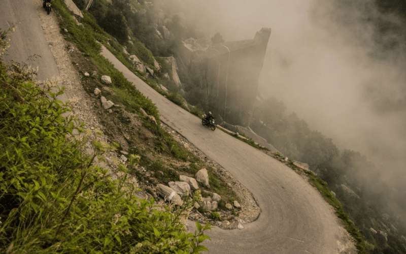 Stockified free photo - Motorcycle on hairpin turn in mountains