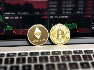 Bitcoin and ethereum emblems