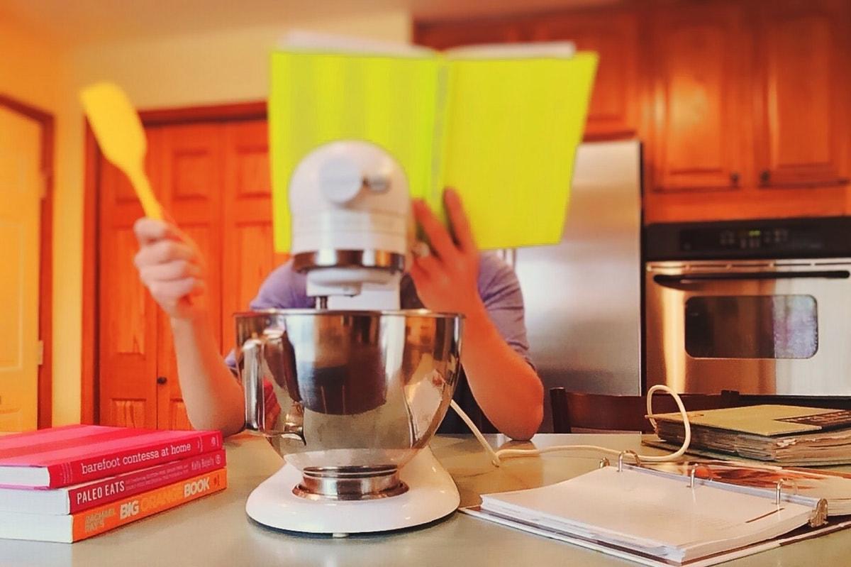 Cook reading a recipe book