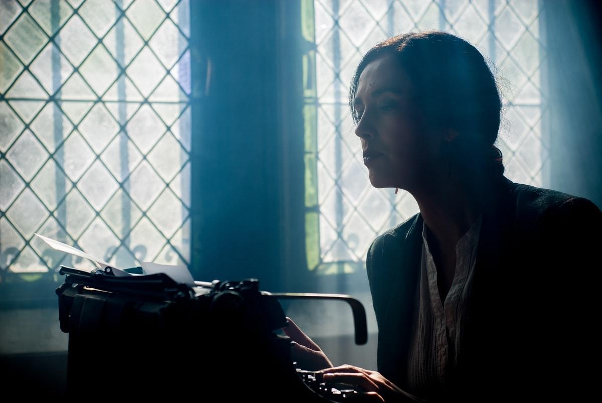 Freelance writer using a typewriter